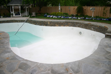 Pool plastered and filling with water
