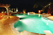 Night view of lagoon pool with vanishing edge.