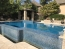Perimeter overflow pool with water at decking level.