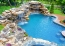 Natural pool with boulder falls and in pool table and stools.